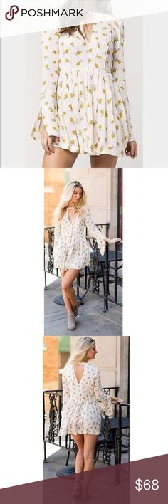 Free People Baby Doll Dress Baby doll dress keyhole neckline in front and back. Long bell sleeves with slit, hidden side pockets, pleated throughout back style. 100% rayon.floral print.33.5 inches length. Free People Dresses Mini