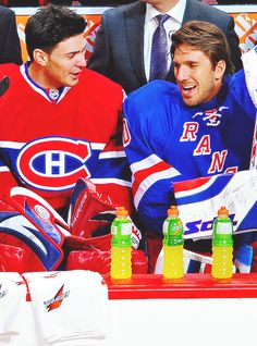 Carey Price and Henrik Lundqvist (and three evenly spaced out Gatorade bottles in front of them)