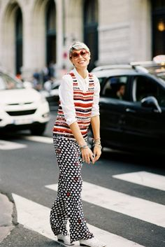 very few people could pull off something like this, but she has so much joy! // Paris Fashion Week SS 2014....Elisa