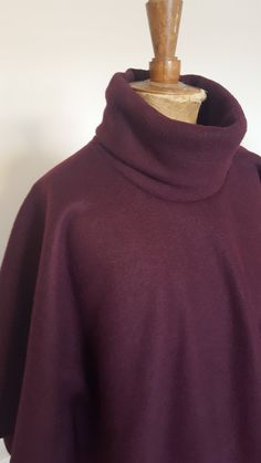 A lovely long soft cosy cape with a roll neck. Made from anti pill super soft fleece it is perfect for wearing over knits or jersey. This cape falls elegantly and has stitching to create draped sleeves, perfect for winter weather.  Available in one size only, fits up to size 16.  100% Polyester, wash at a low heat and dry flat.  All my items are designed and made in my home in Berkshire, creating new and interesting clothing with only a small number of each design made. From drafting the… Roll Neck, Cosy, Knits, Size 16, Stitching, High Neck Dress, Turtle Neck, Weather, Number