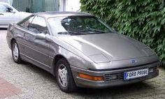 Ford Probe; mine was navy with the red pinstripe!