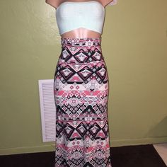 Bandeau Top W/matching Maxi Skirt Mint green bandeau top with matching green, coral, pastel pink and black maxi skirt. This set was worn only ONCE. It still is in great condition. This set runs a little big, therefore would fit a medium or large perfectly. The stretch in the skirt is very good 92% polyester and 8% spandex. Other