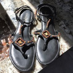 COLE HAAN SANDALS Black Leather. Cushioned Insoles. WOOD BEADED a Embellishment Gold. Wrap Around Ankle Straps.  Hardware Brand New. Never Worn. NWOT. Cole Haan Shoes Sandals
