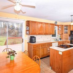Gorgeous kitchen with lots of oak cabinets, center island and dinette area! The back deck and screened in porch makes this the perfect spot to entertain friends or family! With deeded rights to Mimosa Recreation you can enjoy swim, tennis and year-round events! #36mimosacircle #ridgefieldct #thechipneumannteam #neumannrealestate #beautifulhomes #ctlistings #realestate #ctrealestate #colonialhome
