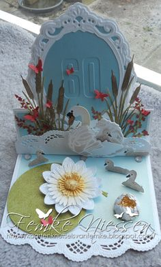 Made by Femke Niessen: easelcard with swan and waterlily. I used several creatables from Marianne Design.