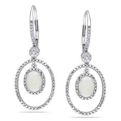 These classy dangle earrings from the Miadora Collection feature iridescent opal stones and round white diamonds set in sterling silver. The dangle earrings are secured with leverbacks.