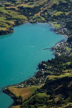 Akaroa is an attractive French settlement within NZ, & Akaroa Harbour, Banks Peninsula, (East of Christchurch),  South Island