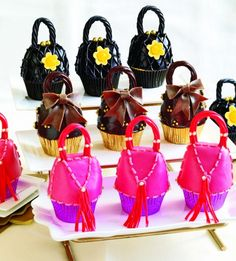 Purse cupcakes and they even made shoe cupcakes!!!!