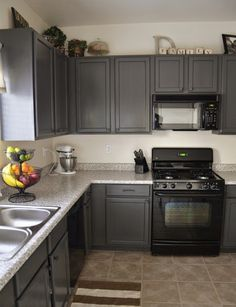Charcoal Grey Kitchen Cabinets. I'd like to put an alternate color in as well.