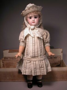 Kindly meet a Jumeau bebe with closed mouth, brown paperweight eyes, creamy bisque, original mohair wig and pate and marked Bebe Jumeau fully jointed