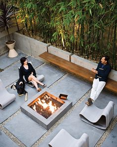 Bamboo in planters between patio and garage, central firepit.