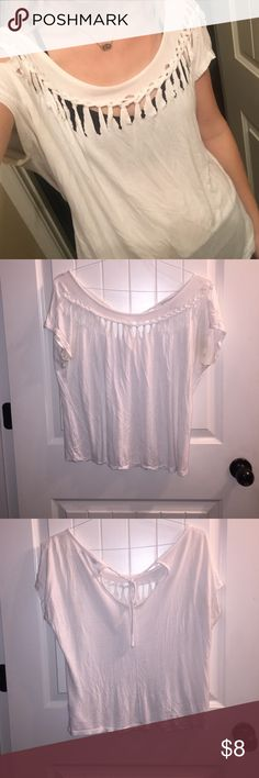 White braided t shirt A little wrinkled. Cotton, in great condition. Slit in the front and ties in the back at the top. Longer crop top/ shorter shirt! Super cute with Jean shorts and converse or sandals Forever 21 Tops Blouses
