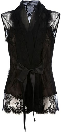 Black cotton blend sleeveless top from Oscar de la Renta featuring a sheer lace-detailed bodice, a v-neck and a silk ribbon self-tie at the front and a scalloped hem.  From lyst.com  via Maria Antonia Pastor