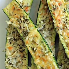 Pre-heat oven to 350F, lightly brush both sizes of the zucchini with olive oil and place on a foil-lined baking sheet. Mix cheese and herbs ...