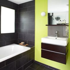 Fresh modern bathroom with green statement wall A brightly-coloured feature wall in an otherwise pared-back scheme can make a massive impact in a simple spa-style bathroom. Go on... have some fun.