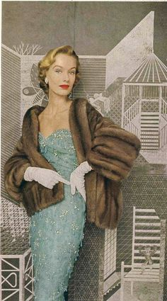 Aqua beaded evening gown worn with mink stole, 1952