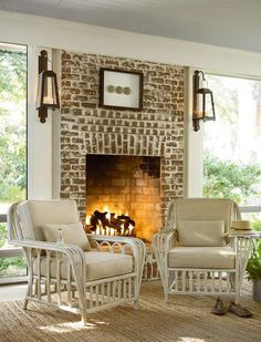 Fabulous porch with fireplace!  Boat House chairs from the Paula Deen furniture collection.