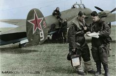 The pilot and navigator Soviet Light bomber Petlyakov Pe-2 discussing the upcoming sortie 9 March 1942.~ BFD