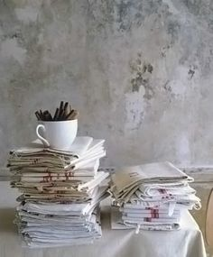 Simple and rustic linens, reminiscent of vintage French tea towels.  LOVE the wall treatment!