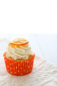 Orange Vanilla Bean Cupcakes with simple candied oranges. Can't wait to make and devour these!  Annie's Eats