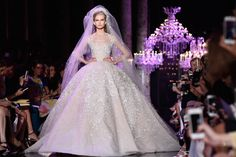 It's that time of year again when we forecast what the future for wedding dresses hold, and we're really excited for what's in store for our brides in 2015! From what we've seen so far you're in for a real treat; from sheer lace, cut off midriffs, shimmering metallics and show-stopping backs. We've picked some of our favourites from the best bridal catwalks. So sit back and take inspiration from some of the most gorgeous dresses set to take centre stage in 2015.