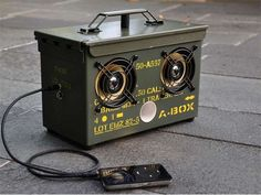 Dustin White made the ultimate office accessory: speakers built inside old .50 caliber ammunition boxes.