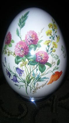 An egg painted with flowers #Easter