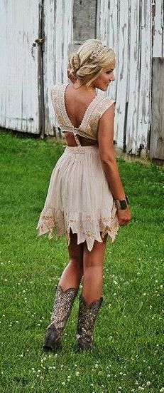 Beige mini dress with brown leather belt and sparkly cowboy boots (Free People)