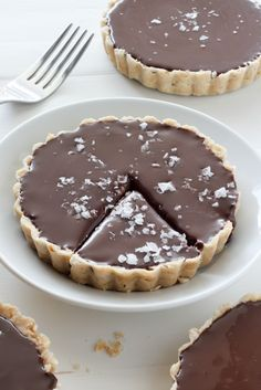 With an all-butter crust and an incredibly decadent chocolate filling – these Chocolate Ganache Tarts are sure to grab your attention! Chocolate Ganache Tart, Salted Chocolate, Chocolate Filling, Decadent Chocolate, Homemade Chocolate, Melting Chocolate, Chocolate Recipes, Chocolate Chocolate, Desserts Menu
