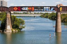 Focus One Point and Breathe, a graffiti mural on the railroad bridge over Lady Bird Lake in Austin, Texas, August Photo Copyright Steve Hopson. Austin Murals, Mural Painting, Fence Painting, Graffiti Murals, Thing 1, Printing Companies, Great Photos, Photo Studio, All Art