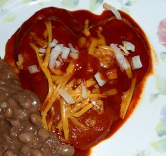 Heartchiladas. Corn tortillas cut into heart shapes with New Mexico Red Chile sauce.
