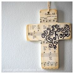 Ceramic cross, modge podge and cover with paper then use a ...