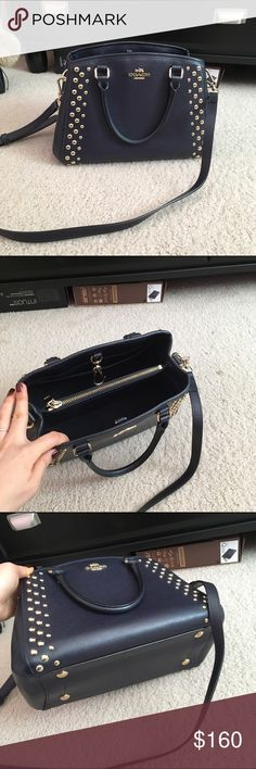 AUTHENTIC Coach handbag Authentic Coach handbag. Very dark navy color, excellent condition. Only worn once to a wedding. Fits a lot of stuff! Coach Bags