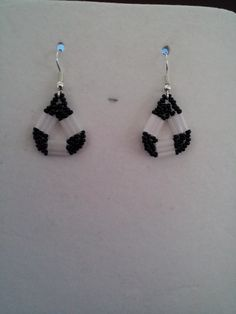 $8.50 1 inch below the earwire               G1 Bugle Beads are a Frosted White