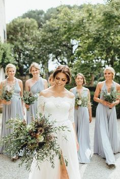 Gray floor-length bridesmaid dresses | Image by Kreativ Wedding