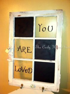 "This is a 6 pane antique window.  There are 3 chalkboards with the saying, ""You Are Loved""."