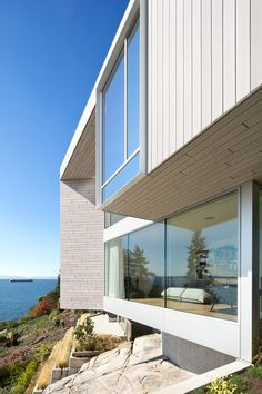This waterfront dwelling that hugs a rocky hillside, by Canadian firm Mcleod Bovell Modern Houses, is designed to make the most of its sea views.