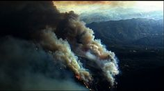 MIDDLETOWN, Calif. (AP) — Some 400 homes were among the hundreds of structures destroyed as fast-moving wildfires raged through communities in Northern California, leaving at least one person dead and sending residents fleeing along roads where some buildings and vehicles were still in flames.