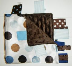 Silky Satin Blue Brown Dots and Minky Brown Dot Ribbon Tab Sensory Blanket for Babies. Has Ribbon Tags for play and chewing.