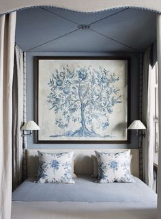 Blue & White floral tapestry at the head of the bed