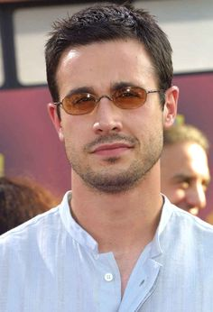 Freddie Prinze Jr. with some super-cute orange + oval sunglasses.   60 Pictures That Perfectly Capture The 2000s