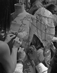 finishing touches backstage at alexander mcqueen spring/summer 2007