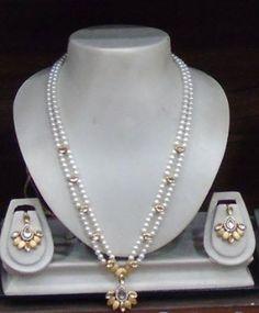 Shell pearl Kundan set