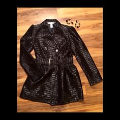 Sexy Black Trench Coat Sharp black on black with black diamond accents and an amazingly flattering belted style, throw this on over your little black dress this New Years Eve, but it's so good looking, you might not want to take it off!! Made by Britney ❤️s Candies - excellent like new condition! Machine washable and dryer safe. Candie's Jackets & Coats Trench Coats
