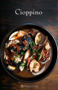Cioppino ~ San Francisco-style cioppino Italian fish stew, with fresh halibut, sea bass, Dungeness crab, shrimp, clams, mussels, and oysters in a savory tomato-based broth. ~ SimplyRecipes.com