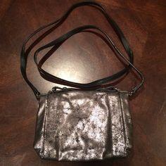 Over shoulder purse Metallic silver. Zipper close. Blue inside. Nonadjustable strap GAP Bags Crossbody Bags