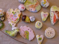 Ready to string into necklaces by Julie Whitmore Pottery, via Flickr
