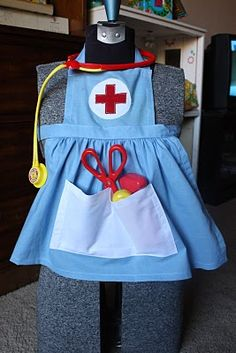 nurse's apron. perfect to go with a play doctor's kit. I cannot wait until my little girl is old enough so I can make this!