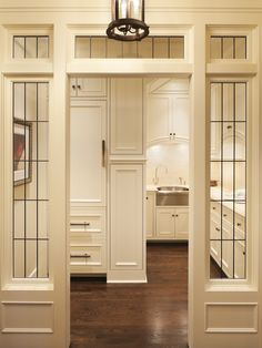Murphy & Co. Design: Butler's pantry with transom windows, creamy white kitchen cabinets with marble.  Oh MAN, do I have the bakeware to fill up this pantry bad boy ♥♥♥
