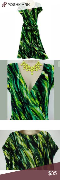 """1X 16 ABSTRACT GREEN PRINT DRESS W/TIE Plus Size Size: 1X Surplice neckline  Faux-wrap style  Removable matching tie around the waist Abstract print in shades of green Slightly high-low midi length bottom hem Measurements:   Bust (armpit to armpit):  44"""" relaxed - stretches to 60"""" Waist: 41"""" relaxed - stretches to 54"""" Hips:  47"""" relaxed Length: 40"""" in front/ 44.5"""" in back (top of shoulder to bottom hem)  Condition:  PRISTINE CONDITION! Fabric Content: 95% Rayon  5% Spandex   Fabric Care…"""